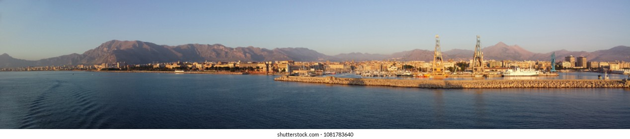 view of Palermo and the harbor at dawn from the sea