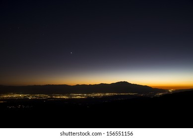 A view of Palm Springs and Coachella Valley at sunset from Key's View at Joshua Tree National Park.