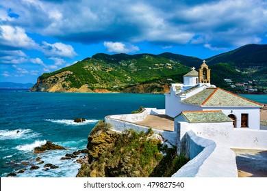 View of Panagitsa Tou Pirgou church over the bay, Skopelos, Greece