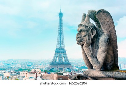 View of Paris with Eiffel Tower and Gargoyle or Chimera of Notre Dame Cathedral, high resolution Picture