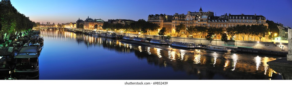 View of Paris Seine riverside in the morning from Concorde Bridge, d'Orsay museum