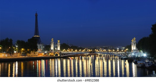View of Paris Seine riverside, Pont Alexander III and Eifel Tower in early morning