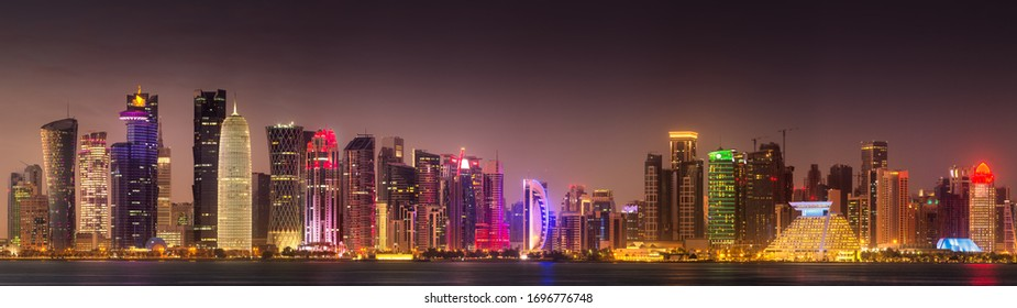 View of park and building in Doha City Center at night, Qatar