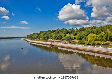 View of the park and the Cathedral of Saints Peter and Paul from the bridge over the river Sozh. Gomel. Belarus