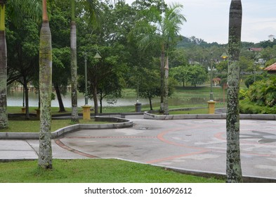 View of park with cloudy weather. Pathway at park. Design of public park in Malaysia.