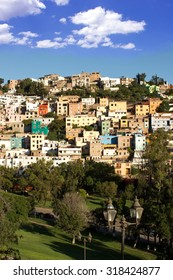 View of Park and Hillside Housing in Guanajuato, Mexico on Sunny Afternoon