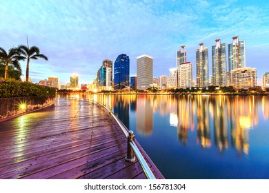 View Park Skyline Bangkok City Thailand Night,Thai City downtown at night with reflection water of skyline buildings,