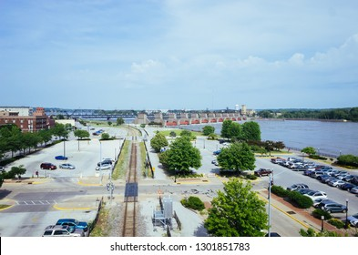 View of parking lots, tran track, and Mississippi River, in Davenport, Iowa, USA