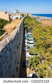 View of parking lot next to city walls in City of Rhodes (Rhodes, Greece)