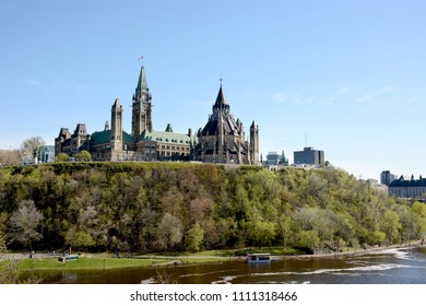 View of the Parliament Buildings and the Ottawa River from Major's Hill Park.