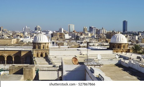 "View of part of the Al-Zaytouna Mosque and the skline of Tunis. In the background the modern buildings of the New City or ""ville nouvelle"". Tunisia, Africa."
