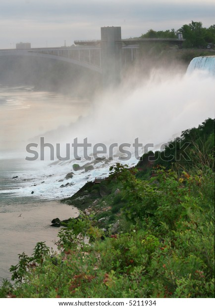 View of a part of American side of Niagara Falls and Niagara River under the Rainbow bridge. Dynamic exposure, sunrise