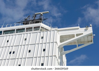 View part of a bridge and port side wing of the vessel