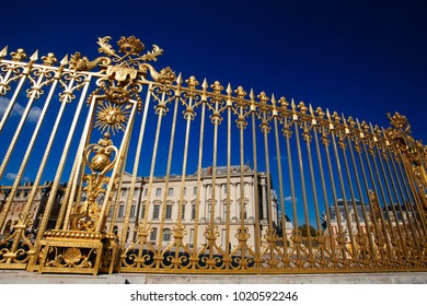 View of the part of a north wing of the Palace of Versailles across his gilding fence on the background of the sky, France