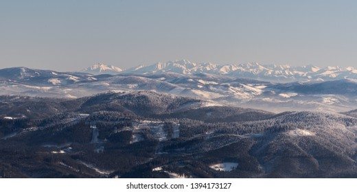 view to part of Zapadne Tatry, whole Vysoke and Belianske Tatry from Lysa hora hill in winter Moravskoslezske Beskydy mountains in Czech republic