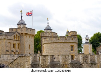 View to parts of the tower of london with the Union Jack from the land side at a cloudy day - London, Great Britain - 08/03/2015