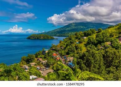A view past a settlement towards Mount Soufriere in Saint Vincent