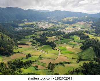 View of patchwork farmland and villages from a lookout near Furnas, Sao Miguel, Azores, Portugal