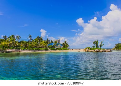 View of the peaceful Caribbean sea with crystal clear water, white clouds and blue sky on a beautiful sunny day. Tilloo Cay, Marsh Harbour, Abaco, The Bahamas.