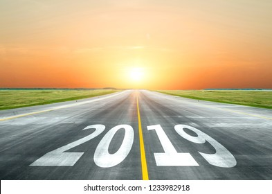 View of the peaceful open road against the setting sun forward to new 2019 year. Concept of success in the future