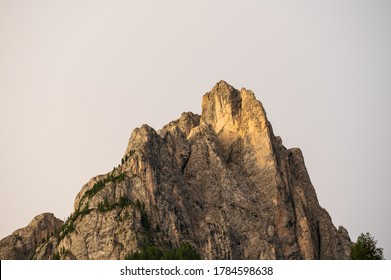 view of the peak of cima 11 and cima 12 inside Dolomites mountains in a clear morning seen by Pozza di Fassa village in Trento province, Italy