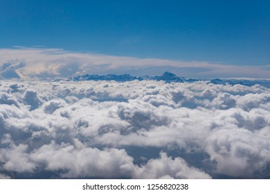 View of peaks of Andes Mountains above clouds