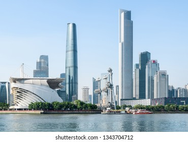 View of the Pearl River and skyscrapers at the Zhujiang New Town on blue sky background. Wonderful modern buildings at downtown of Guangzhou, China. Guangzhou skyline.