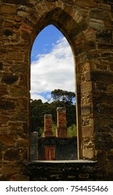 view of penal colony  ruins through the  convict church window  at port arthur historic site, port arthur, tasmania, australia