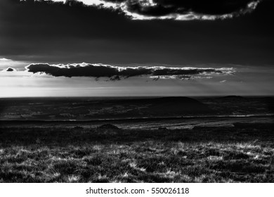 A view from Pendle Hill. Clouds cast shadows on Lancashire Hills. In distance Blackpool and Irish sea. Lancashire, England, UK