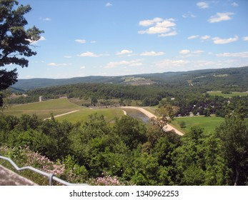 view of Pennsylvania valley from mountainside with blue sky and clouds