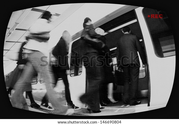 View of people entering into train through surveillance screen
