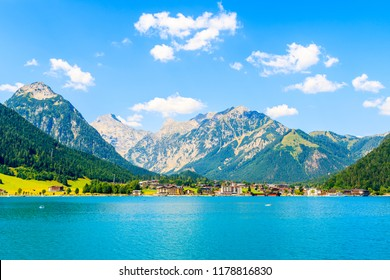 View of Pertisau village on shore of beautiful Achensee lake on sunny summer day, Tirol