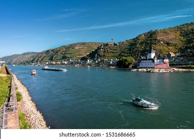 View of Pfalzgrafenstein Castle, known as the Pfalz, a famous toll castle on the Falkenau island and Gutenfels castle on the bank of the Rhine river, on an autumn morning.