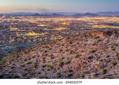 A view of Phoenix, Arizona from South Mountain after sunset.
