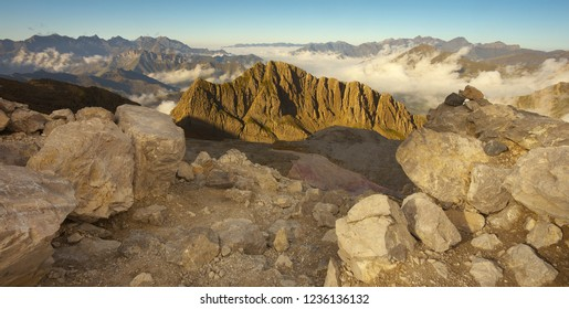 View of a Pic de Sarradets with a mountain valleys covered with clouds, Pyrenees Occidentales, France
