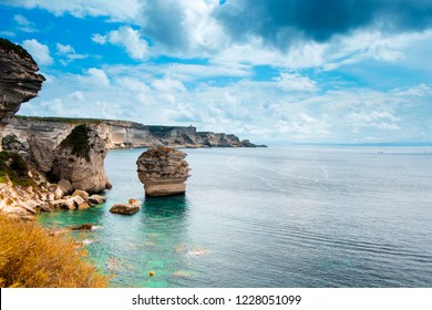 a view of the picturesque landscape of cliffs over the Mediterranean sea in Bonifacio, Corse, in France, highlighting the famous Grain de Sable sea stack in the center