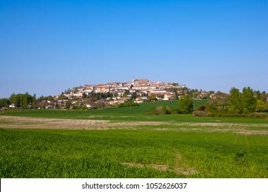 """View of picturesque Monflanquin, Lot-et-Garonne, France. The hilltop bastide town belongs to """"Les Plus Beaux Villages de France"""" association."""