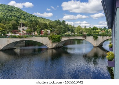 View of the picturesque town of Shelbourne Falls, Massachusetts and it's scenic Bridge of Flowers.