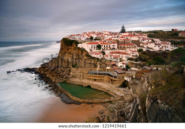 View of the Picturesque village Azenhas do Mar, on the edge of a cliff with a beach below. Landmark near Sintra, Lisbon, Portugal, Europe. landscape at sunset.