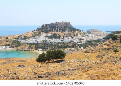 View to the picturesque village of Lindos with the acropolis and the harbour, island of Rhodes, Greece