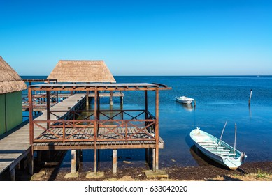 View of a pier and boats in the town of Champoton, Mexico
