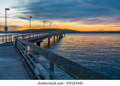 A view of the pier at Des Moines, Washington at sunset.
