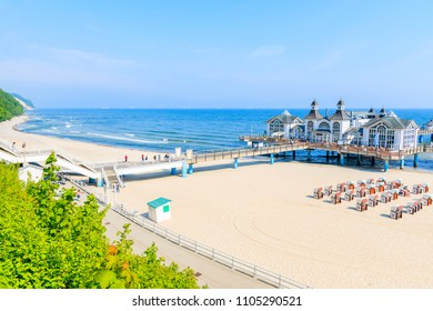 View of pier with historic building on sandy beach in Ostseebad Sellin, Ruegen island, Baltic Sea, Germany