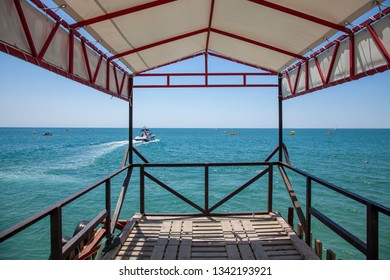 View from pier: motor boat and catamarans in the sea. Scenic tropical landscape,