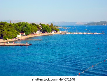 View from the pier on the beach with pines in Vodice, Croatia.