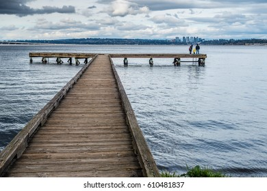 A view of a pier on Lake Washington in Seattle. Bellevue can be seen in the distance.