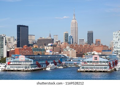 The view of piers by Hudson River of Manhattan island West Midtown (New York City).