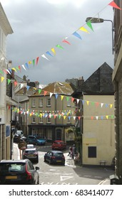 A view of Pike street in Liskeard, Cornwall, adorned with bright and colourful bunting