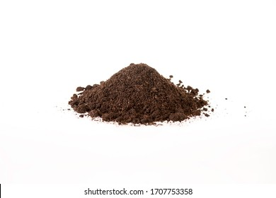 View of a pile of brown soil located on a white background