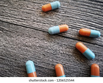 view of pills or capsules on the wooden background